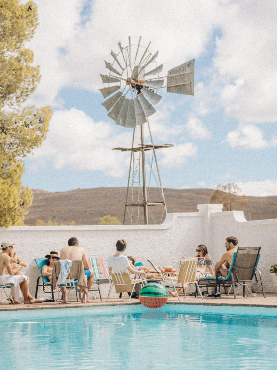 A pool party under the windmill in the desert matjiesfontein south africa